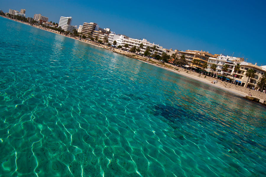 Cala Millor resort town and transparent waters of Mediterranean